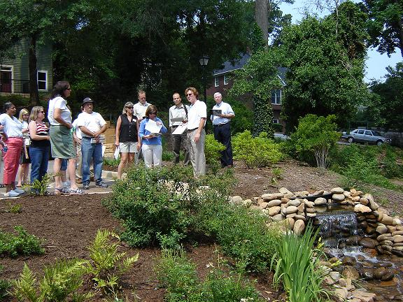 Field trip participants view a small waterfall, designed as both a water feature and a stormwater management option, at a condo development in downtown Greenville ©  John Tynan, 2006